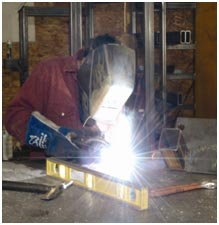 welder working on a metal frame