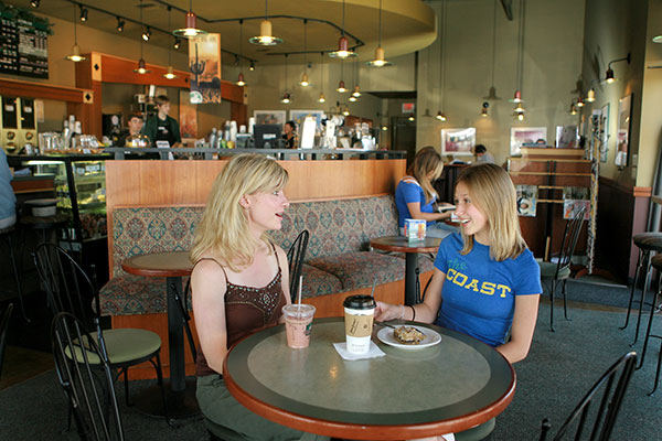 two students have coffee and snacks at City Brew