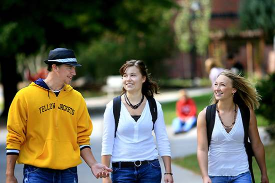 students walking and laughing as they cross the MSUB university campus