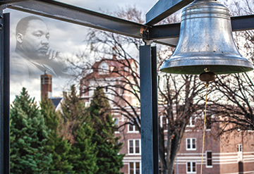 photo of Martin Luther King, Jr. imposed on a photo of the MSUB campus and campus bell.