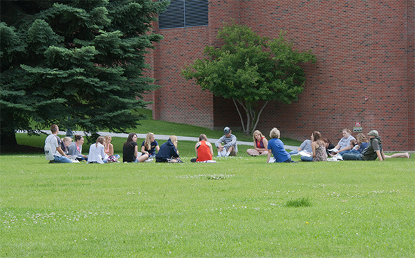 students at an outdoor class session