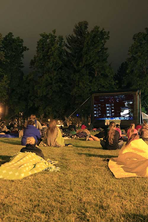 MSUB students enjoy an outdoor movie on the MSUB university campus
